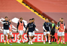 Leeds United players warm up at Anfield
