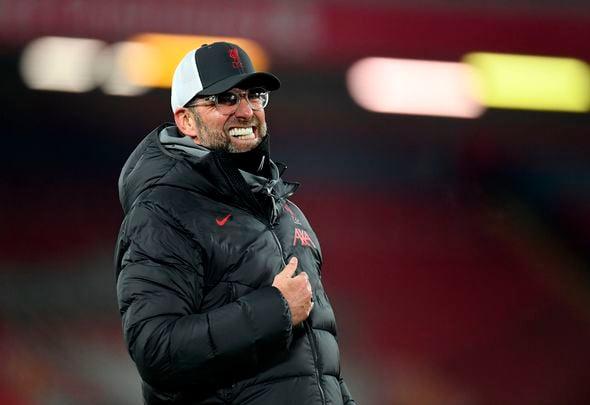 Manajer Liverpool Jurgen Klopp meringis